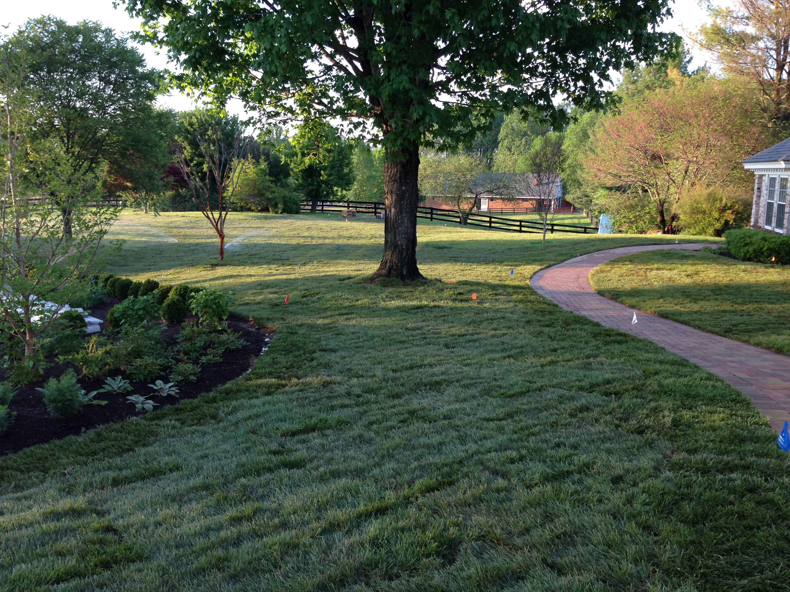Landscaping mowing mulching earth effects landscapes for General garden services